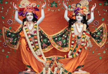 The two brothers Nitai on the left and Gauranga on the right,leading the way by dancing and chanting out of dark times